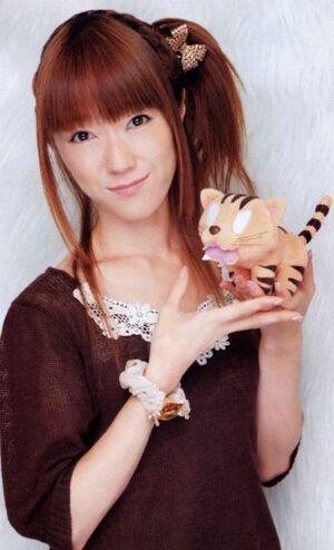 Rie Kugimya with the palmtop tiger plush