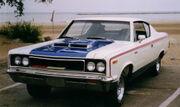 1970 AMC The Machine 2-door muscle car in RWB trim by lake