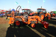 Kubota tractor fitted with loader and Backhoe attachment at LAMMA 2012 -IMG 3833
