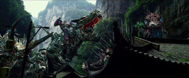 File:Drift Riding Slug Optimus Riding Grimlock Crosshairs Riding Scorn 4.jpg