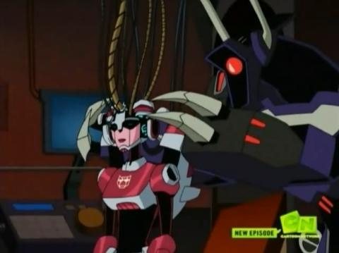 File:TFA Shockwave accessing arcee.jpg