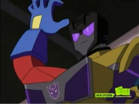 File:Swindle with optimus hand in tummy hatch.jpg