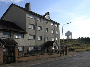 Derelict housing wlter tower at bk