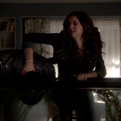 Katherine dunks Damon's head to the fish tank filled with vervain water.
