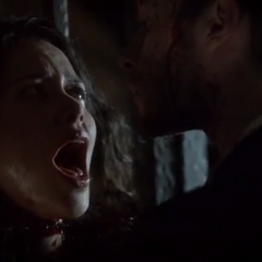 Klaus cutting Kimberley's head off.