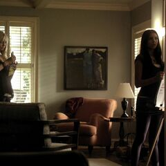 Same window behind Caroline, to the right is the side window, the fireplace is behind Elena on the right