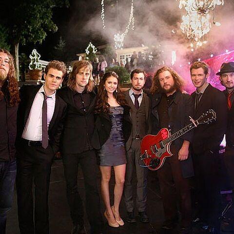 Paul Wesley, Nina Dobrev and Joseph Morgan with the band