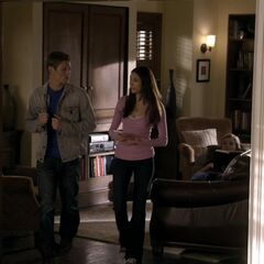 Same entrance to living room 2, Jenna is on the leather couch, the TV is in the cabinet behind Elena and Matt (it closes)