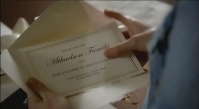 File:Caroline opens Mikaelsons' Ball invitation.png