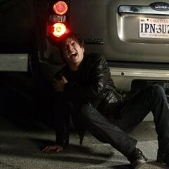 Damon pretending to have been hurt by Logan (who is not in the picture).