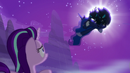 Two changelings seizing Princess Luna from the moon and Starlight