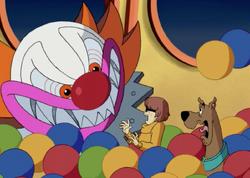 The Clown ambushes Velma and Scooby
