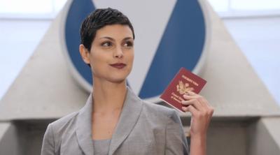 Anna Holding Her Visa