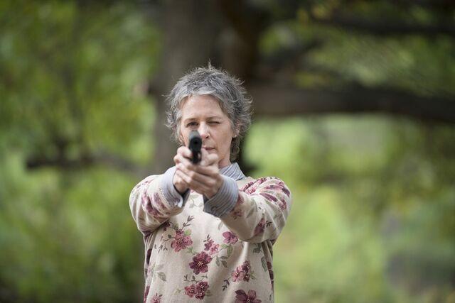 File:Carol aims gun.jpg