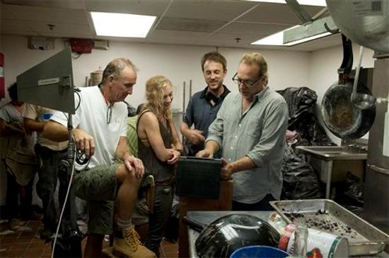 File:Emily looking at something with producers and other crews.jpg
