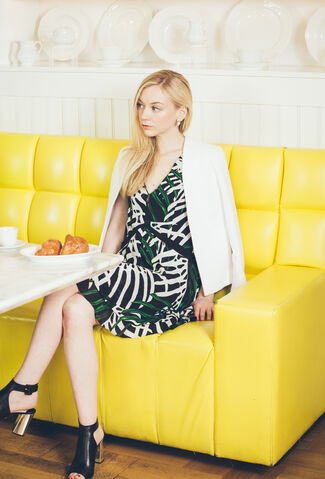 File:Emily Kinney so cool and beautiful in a yellow sofa.jpg