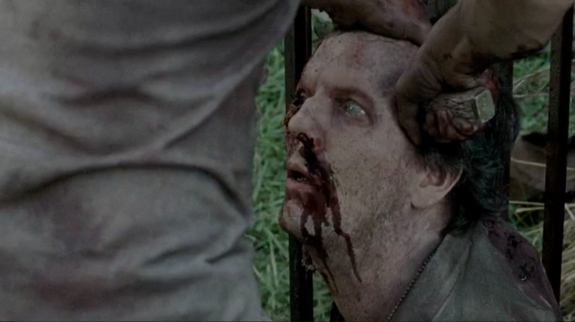 File:A zombified David being stabbed in the head by Glenn Rhee.png