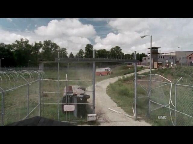 File:Prison fence wreck.jpg