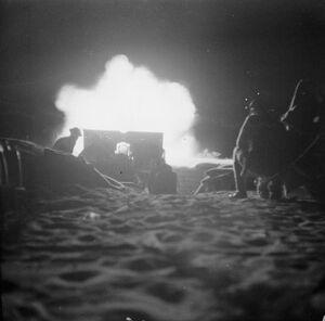 British 25 pounder firing at night, Second Battle of El Alamein, October 23, 1942