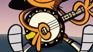 S1e7 close up of Wander's banjo