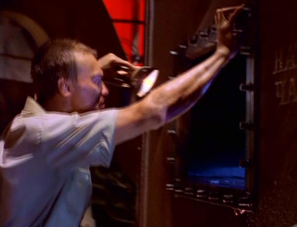 File:Dmitri looks inside sewage tank.jpg