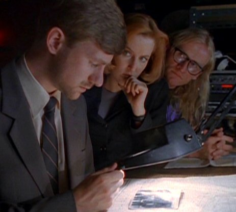 File:Byers examines photograph.jpg