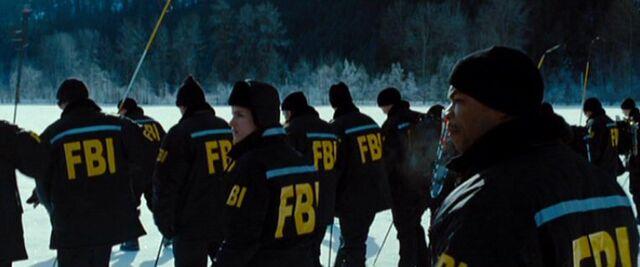 File:Mosley Drummy and Dakota Whitney lead an FBI search team.jpg