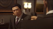 Aoyama groans toward Morinaga's gun aiming at him