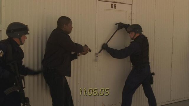 File:5x05-hangar-bb-door.jpg