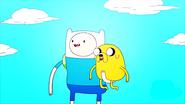 S2e16 Finn holding Jake