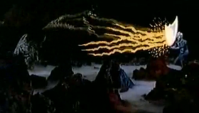 King Ghidorah's gravity beams are reflected back by Zone Fighter's Hyper Barrier