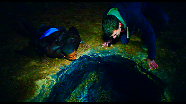 File:The boys around the edge of the hole..png
