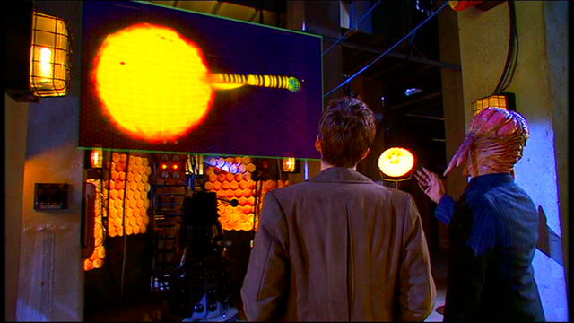 File:Dalek Sec informs the Doctor of the incoming Solar Flare..png