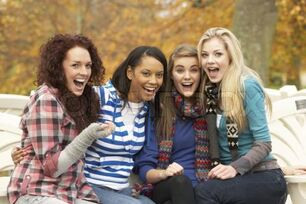 1239130-767114-group-of-four-teenage-girls-sitting-on-bench-in-autumn-park
