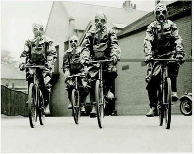 File:Bicycling gas masked guys.jpg