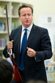 David Cameron with gun