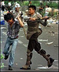 Police man riots asia