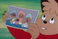 Alvin Showing Baby Photo.png