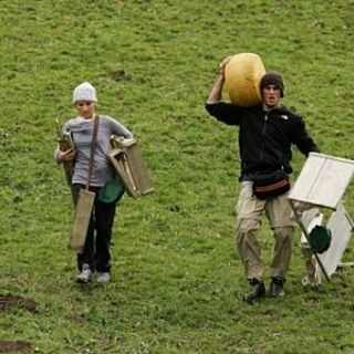 Amanda &amp; Kris carrying cheese wheels in <a href=