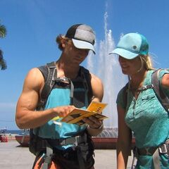 Adam &amp; Bethany reading their detour clue in <a href=