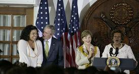 President George W Bush congratulates singer Jordin Sparks