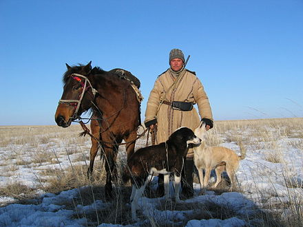 File:440px-Kazakh shepard with dogs and horse.jpg