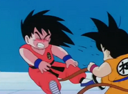Goku doll kicks him in the face2