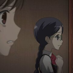 Sayuri watches in fear as the others attack Mei and Kouichi.