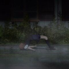 Yumi lies dead in the rain.