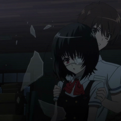 Kouichi saves Mei from falling glass in the old school building.