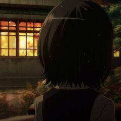 Mei looks at the burning inn.
