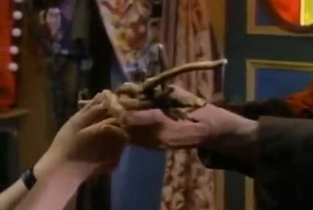 File:2magicianbeinghandedthewand.png