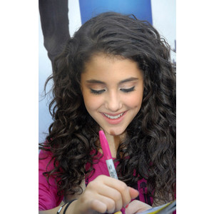 File:Ariana writing autographs.jpg