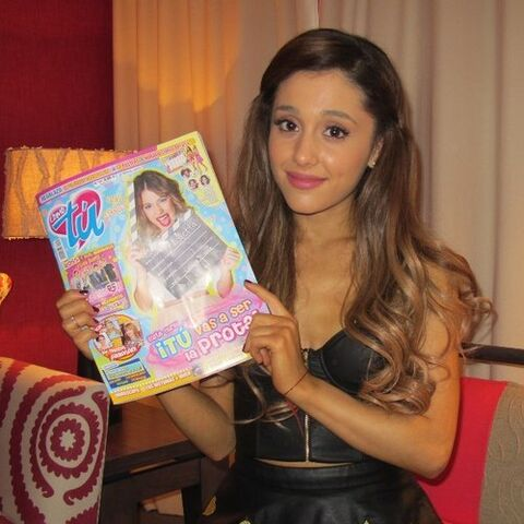 Ariana holding an issue of <i>Tu Magazine</i>.